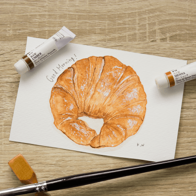 #WorldWatercolorGroup - watercolor sketch by Keiko Weafer Japan of croissant - #doodlewash